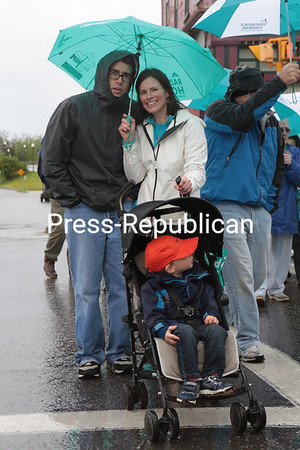 Monday, May 27, 2013. Scores of residents brave the driving rain during the second-annual Walk of Hope and Spring Festival in Plattsburgh's Trinity Park. The Saturday morning event featured live entertainment, food and activities. The walk and festival aimed to raise $100,000 for MassGeneral Institute for Neurodegenerative Diseases, which includes ALS, Alzheimer's, Parkinson's and Huntington's. <br /><br />(P-R Photo/Gabe Dickens)