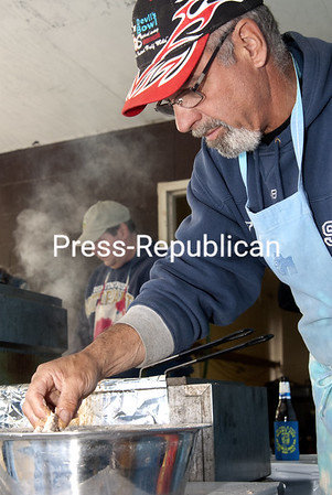 Thursday, May 30, 2013. Volunteers prepare fried pike during the 28th annual Happy Pike at the Chazy Recreation Park on May 26. The annual fishing derby nets over 200 pounds of Northern Pike that are fried two ways for derby goers.  <br /><br />(Staff Photo/Rachel Moore)
