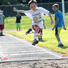 Sunday, July 28, 2013. Area youths compete during a youth track and field series at the SUNY Plattsburgh track behind the Field House. The free event, hosted by college's track and field program and the City of Plattsburgh Recreation Department, featured children ages 5 through 12 competing in the shot put, 50, 100 and 400-meter dashes, 800-meter run and the mile. <br /><br />(P-R Photo/Gabe Dickens)