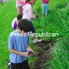 Tuesday, May 26, 2009. The Peru Intermediate School's Citizenship Committee work to tidy up the garden in front of the school during an early morning meeting.<br><br>(P-R Photo/Rachel Moore)