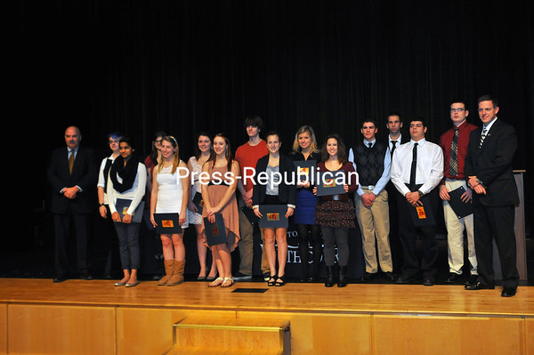 Tuesday, January 15, 2013. Teens are inducted into the Clinton County Youth Court. All 16 who participated in an 11-hour training over winter break passed the bar exam with an average score of 91 percent and have volunteered to make a one-year commitment. The program provides an opportunity for teens ages 13 to 18 to serve as members of a court — including in the role of judge, prosecutor, defender and jury — for young people who have committed low-level offenses. Typical cases heard by the Youth Court include petit larceny, criminal possession of stolen property, criminal possession of a controlled substance and criminal mischief, according to Clinton County District Attorney Andrew Wiley, who attended Monday's induction. <br /><br />(Staff Photo/Kelli Catana)
