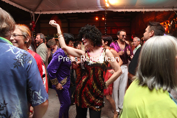 Sunday, June 24, 2012. Disco Fever Dinner and Show at the Nomad Center in Plattsburgh Saturday evening. The event is the largest annual   fundraiser for the CVPH Foundation, which is expected to raise more than $30,000 to help fund various programs at the hospital. <br /><br />(P-R Photo/Gabe Dickens)
