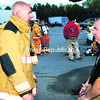 During a break, program co-creator Dan Baker and Mineville firefighter Patrick Tromblee discuss how the training has been going.