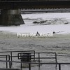 Tuesday, March 10, 2009. Icy water creeps over into the Riverwalk Park area in the City of Plattsburgh due to ice jamming up in the Saranac River near Macdonough Monument.<br><br>(Staff Photo/Kelli Catana)