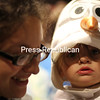 """Tiana Murchison and Adalyn Latow, 19 months, of Plattsburgh just """"let it go."""" (Mike Pitts/P-R PHOTO)"""