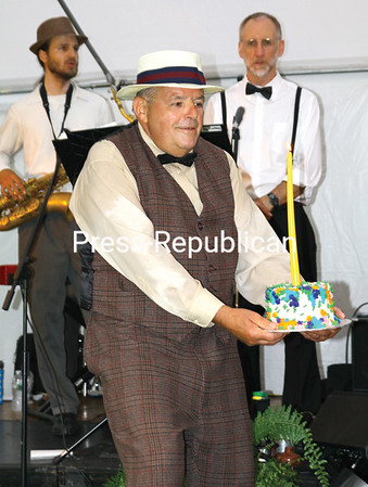 ALVIN REINER/P-R PHOTOS<br /> Ticonderoga Historical Society Board President Bill Dolback presents the Hancock House's 90th birthday cake. To accommodate all the guests, cupcakes were served. Visit pressrepublicanphotos.com for bonus photos from the 90th anniversary celebration of the Hancock House's construction.
