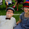 ALVIN REINER/P-R PHOTO<br /> Andrea Anesi and Kyle Miller of Port Henry relax to music on the lawn of the Hancock House.