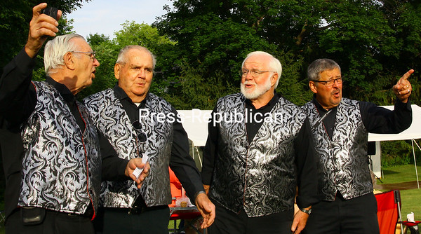 ALVIN REINER/P-R PHOTO<br /> The Elderly Brothers Bob Whitney (from left), Jay Van Vracken, Larry Wilbur and Rich Gervais harmonized as they strolled around the Hancock House museum's grounds.