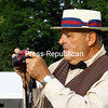 ALVIN REINER/P-R PHOTO<br /> Though the digital camera was an anachronism, Ticonderoga Historical Society Board President Bill Dolback was nattily dressed in 1920s attire.