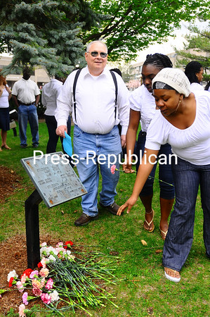 Tuesday, May 4, 2010. Memorial ceremont at the plaque in front of the Kehoe Administration Building, where people have gathered every May 4 to honor the victims of the Kent State shootings of 1970.<br><br>(Staff Photo/Kelli Catana)