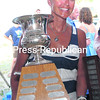 Vivien Allan holds up the Mayor's Cup after being part of the winning crew that sailed Avena to victory in Saturday's Mayor's Cup Regatta racing division.<br><br>(P-R PHOTO/GABE DICKENS)