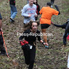 Sunday, October 23, 2011. Runners navigate mud and cobwebs Sunday afternoon during the first-ever Monster Dash 5K and Goblin Gallop Kids Fun Run at Banker Orchards in Plattsburgh. The run benefited Medicine Horse Farm. Participants were also given red flags to wear around their waist, which represents their lives, and had to prevent them from being captured by monsters lurking about.<br><br>(P-R Photo/Gabe Dickens)