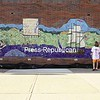 Wednesday, August 12, 2009. The Clinton County History Through the Eyes of its Children mosaic was unveiled on the exterior wall at the Government Center in Plattsburgh Wednesday. More than 1,000 students from nine Clinton County schools took part in the project, which depicts the county's history through thousands of tiny tiles that were placed to make the 38-by-9-foot mosaic. The project began last fall under the guidance of Bucky Seiden, Sue Burdick Young, Sandra Morse and school teachers, and with Clinton County Historian Anastasia Pratt teaching local history to students. The students then created scenes from the teachings, and those drawings were transferred onto tiles to depict Clinton County history since its charter in 1788. <br><br>(Staff Photo/Michael Betts)