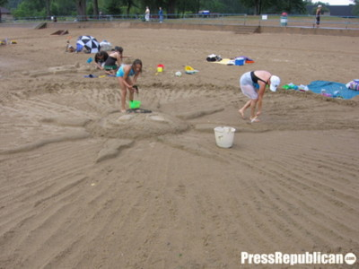 Wednesday, August 15, 2007. This year's Sand Sculpture saw abbout 35 entries with sculptures ranging from cartoon characters, Spongebob and Bart Simpson  up to our favorite sea monster, Champy.  A brief rain-storm sent a couple of participants home but not before creating their entries.