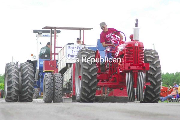 Sunday, July 12, 2009. 19th-Annual Champlain Valley Antique Gas Engine and Tractor Association Exhibition at the Clinton County Fairgrounds. The event featured a tractor pull,  stage coach rides and a tractor parade.<br><br>(P-R Photo/Rachel Moore)