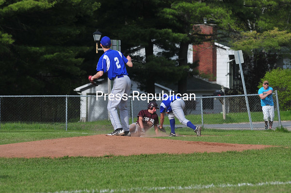 Tuesday, May 8, 2012. The Northeast Clinton Central School Cougars held a 1-0 lead before erupting for five runs in the fourth inning to beat the Peru Indians, 11-2, in CVAC baseball. <br /><br />(Staff Photo/Kelli Catana)