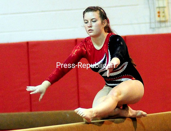 ROB FOUNTAIN/STAFF PHOTO 9-21-2016 Beekmantown's Kailey Quackenbush performs a routine on the beam Tuesday during a gymnastics meet against Plattsburgh High in Beekmantown.
