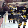 Lake Placid's Ryan Kane (19) celebrates with teammates after Evan Damp scored first goal of the Section VII championship game against Beekmantown Tuesday at Stafford Ice Arena. Lake Placid defeated Beekmantown 3-2. (ROB FOUNTAIN/STAFF PHOTO)