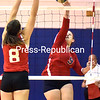 AuSable Valley's Karissa Stevens (9) tries to slip a shot over the net in front of Saranac's Elizabeth Trudeau (8) Tuesday, November 3, 2015 during Girls Volleyball Section VII Class C Quarterfinals in Clintonville. (ROB FOUNTAIN/STAFF PHOTO)