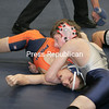 Andy Anderson works to pin Danny Franco in this 125-lb bout in the opening round of competition at the state championships on Mar.8, 2008, in Rochester, N.Y. anderson won with a pin. (Photos for The PR by Mike Okoniewski)<br><br>(PR-Photo/Michael Okoniewski)