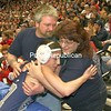 Peru's Jacob Goddeau hugs his parents Robert and Mellisa Goddeau after besting Section Six's Carlene Sloberski in the 96-lb final at the state wrestling championship in Albany, N.Y., on Saturday evening, Feb. 28, 2009.  Goddeau won this bout for the state title. (PR Photo by Mike Okoniewski)