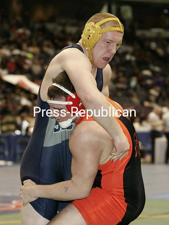 Northern Adirondack's Mike Riley battles against his 215-lb opponent , Section Six's Pat Langworthy in the preliminary rounds of the NYSPHSAA state championships  on Friday at the Times Union Center in Albany, N.Y. Feb. 26, 2010. Riley won this bout.  (PR photos by Mike Okoniewski)