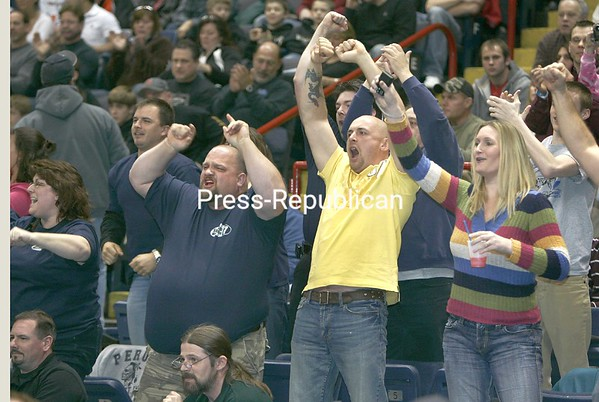 Peru fans cheer Jacob Goddeau victory over Section Six's Carlene Sloberski in the 96-lb final at the state wrestling championship in Albany, N.Y., on Saturday evening, Feb. 28, 2009.  Goddeau won this bout for the state title.From left are John Desereaux, Chad Henry, and Carol Seymour. (PR Photo by Mike Okoniewski)