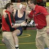 Saranac's Ryan Guynup celebrates with coaches Sean Nolan and Heath Smith after  besting his 135-lb foe, Section Two's Randy White, in the quarter final round of the NYSPHSAA state championships  on Friday at the Times Union Center in Albany, N.Y. Feb. 26, 2010. Guynup won to advace to the semi finals Saturday. (PR photos by Mike Okoniewski)