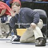 Section 7 coah Hogan coaches his son Patrick in this 119-lb bout in the opening round of competition at the state championships on Mar.8, 2008, in Rochester, N.Y. It's Hogan's first time coaching his son at the states. (Photos for The PR by Mike Okoniewski)<br><br>(PR-Photo/Michael Okoniewski)