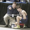 Section 7 coah Hogan coaches his son Patrick just after his loss in his 119-lb bout in the opening round of competition at the state championships on Mar.8, 2008, in Rochester, N.Y. It's Hogan's first time coaching his son at the states.  (Photos for The PR by Mike Okoniewski)<br><br>(PR-Photo/Michael Okoniewski)