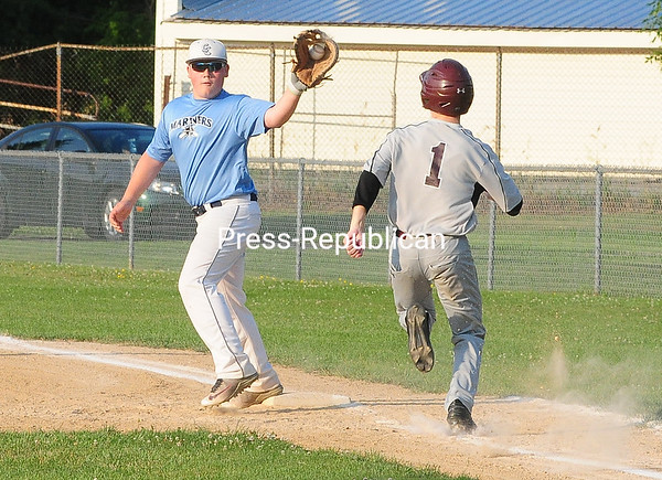 ROB FOUNTAIN/STAFF PHOTO  7-20-16<br /> Champlain Cougars play the Clinton County Junior Mariners Wednesday at Lefty Wilson Field in Plattsburgh. Cougars defeated the Mariners 5-4.