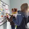 NCCS Reality Check members Kali Bushey and Danielle Babbie put up fliers on April Fools Day to raise awareness about tobacco marketing.<br /> <br /> Photographer's Name: Kimberly  Cummins<br /> Photographer's City and State: plattsburgh, NY