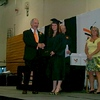 Liz Davies receiving her diploma from the superintendent of City School District