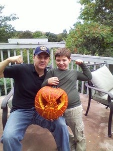 Together Daddy Al and son Q can do anything they show off their creation of the Spider man Pumpkin