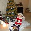 Dalton 7 months old dressed as Santa enjoying milk & cookies at his nana's house