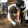 Master Gardener, Kathy Hall, instructs a young high school student on planting seedlings at Chiquilistagua Public School. (Photo/Bonnie Black)