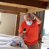 Bill Calmbacher sprays insecticide on the bunks in preparation for Mission 32 travelers' arrival on Tuesday night.