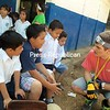 Sam Politi speaks with some young elementary boys at San Luis School while a team was there to outfit a new kitchen for the school. (Photo/Bonnie Black)