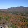 "Sentinel Range north to Wilmington Gap. Colors from Cobble Mountain behind Mirror Lake in North Elba. <a href=""http://web.mac.com/kdedam/iWeb/Site"">View more fall foliage photos by Kim Dedam</a>"