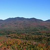 """Sentinel Range north to Wilmington Gap. Colors from Cobble Mountain behind Mirror Lake in North Elba. <a href=""""http://web.mac.com/kdedam/iWeb/Site"""">View more fall foliage photos by Kim Dedam</a>"""