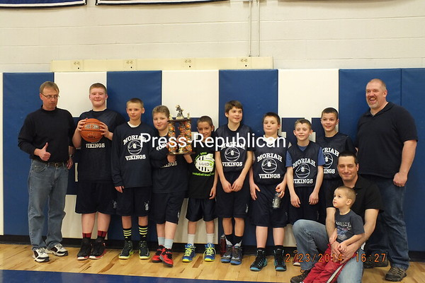 The Moriah Vikings 5/6 grade team won the  IAABO youth basketball tournament Division A Championship by defeating the Hoosick Falls team 42-35 in the finals. Left to Right: Jason Strieble (Coach), Michael Rollins, Jeffrey Strieble, Maddox Blaise, Rowan Swan, Logan VanBuren, Michael Flanigan, Luke Smith, Braden Swan, Wes Rollins (Coach), Kneeling: Bart Swan (Coach), Quincy Swan<br /> <br /> Photographer's Name: Holly Rollins<br /> Photographer's City and State: Port Henry, NY