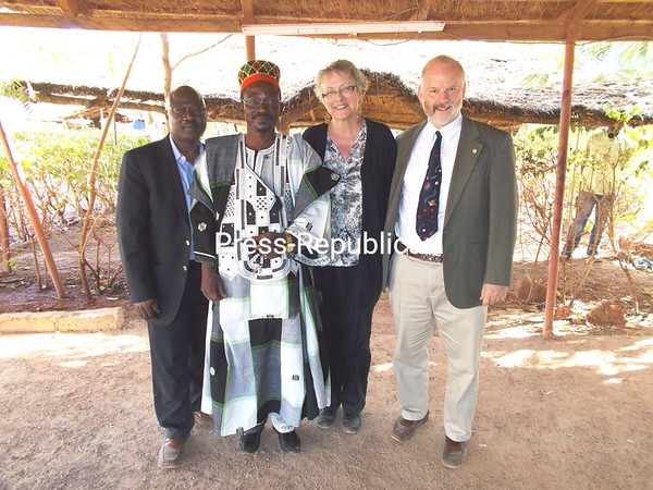 From left to right: Jean Ouedraogo; Village Chief of Gampela, Burkina Faso; Marguerite Adelman; and Robert Ackland celebrate laying the cornerstone for a new school in Gampela, Burkina Faso.  The school is being built by the Program for African Growth through Education (P.A.G.E., Inc.), a non-profit organization located in Plattsburgh.  Ouedraogo, Adelman, and Ackland are all on the Board of Directors for P.A.G.E., Inc., and traveled to Gampela to lay the cornerstone.<br /> <br /> Photographer's Name: Marguerite  Adelman<br /> Photographer's City and State: Plattsburgh, NY
