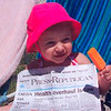Ava Perry of Plattsburgh takes a Popsicle break and looks at the Press-Republican while on vacation with her parents, Jason and Jess Perry, in Daytona Beach, Florida in April.