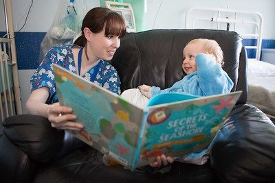 DKANE 22/04/2016 REPRO FREE  Laura O'Connell, Health Care Assistant reading to 21 month old Cormac Walsh from Glounthaune pictured at St. Anne's Children's Ward at the Mercy University Hospital on World Book Night on Saturday, April 23rd with new books donated by Vibes & Scribes to support the Mercy Kids + Teens Appeal. For more information see www.mercyfundraising.ie. Pic Darragh Kane