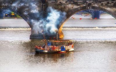 smoke stack on charles bridge river