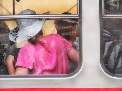 WOMAN WITH HAT ON TRAM IN PRAGUE