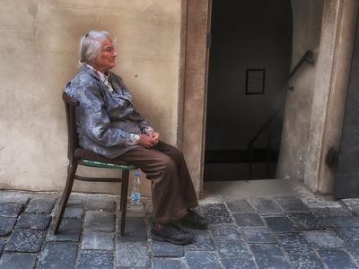 OLD WOMAN AT SYNAGOGUE
