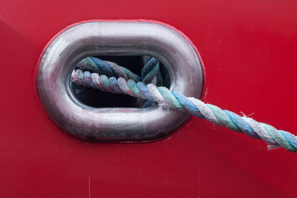 Rope and red boat.