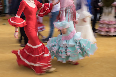 Motion-blurred flamenco dresses.