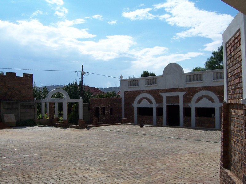 Another angle from the carpark corner of the back of the chapel, The left arches are to guide guest and visitors to the opposite property that has a total different styling and pool and gardens. The tiny building inbetween the owner wanted to make into a covered BBQ of all things ..go figure..